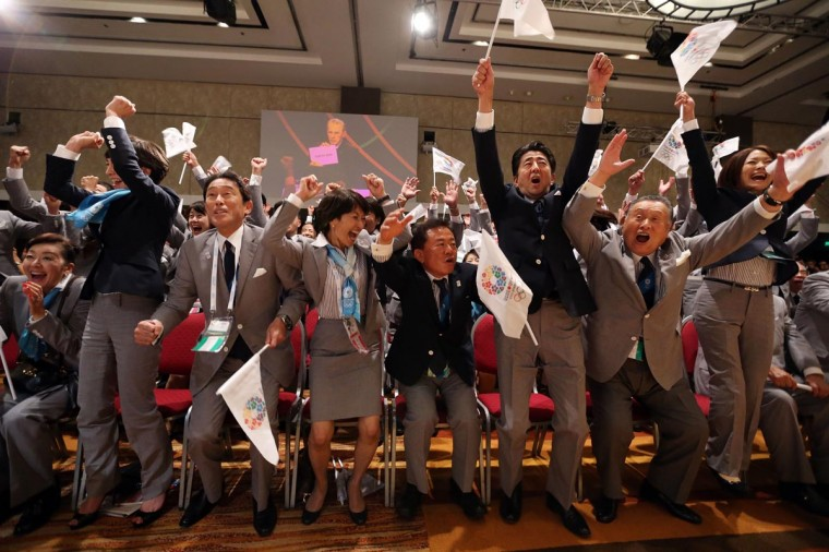 The Tokyo 2020 bid delegation celebrate as Tokyo is awarded the 2020 Summer Olympic Games during the 125th IOC Session - 2020 Olympics Host City Announcement at Hilton Hotel on September 7, 2013 in Buenos Aires, Argentina. (Ian Walton/Getty Images)