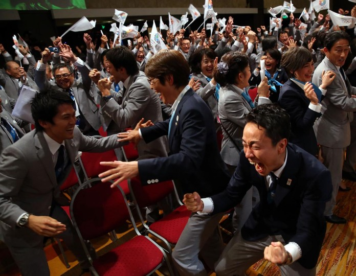 Olympic fencing medalist, Yuki Ota (R) celebrates with the delegation as Tokyo is awarded the 2020 Summer Olympic Gamesduring the 125th IOC Session - 2020 Olympics Host City Announcement at Hilton Hotel on September 7, 2013 in Buenos Aires, Argentina. (Alexander Hassenstein/Getty Images)