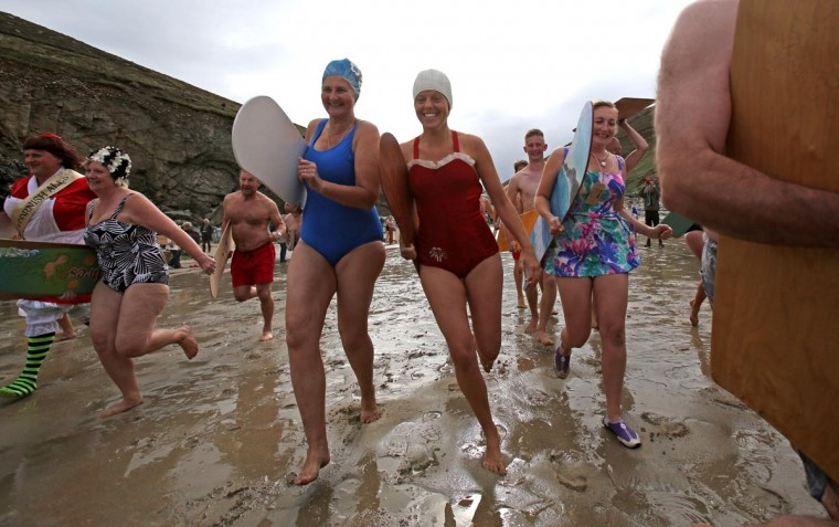 Belly boarders run into the sea to take part in the first heat of the annual World Belly Boarding Championships at Chapel Porth on September 8, 2013 in Cornwall, England. (Matt Cardy/Getty Images)