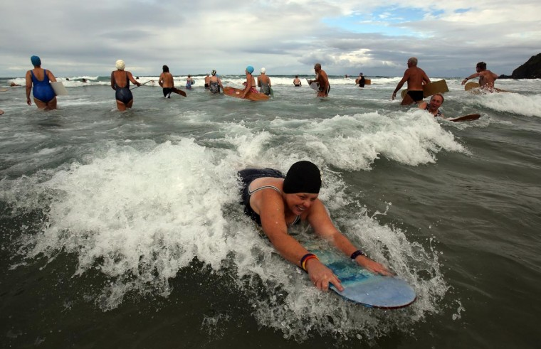 Belly boarders catch a wave as they take part in the first heat of the annual World Belly Boarding Championships at Chapel Porth on September 8, 2013 in Cornwall, England. (Matt Cardy/Getty Images)