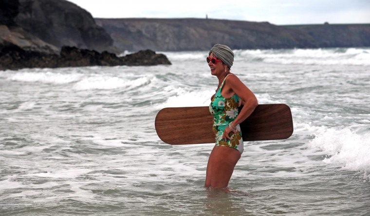 A belly boarder takes part in the senior ladies heats of the annual World Belly Boarding Championships at Chapel Porth on September 8, 2013 in Cornwall, England. (Matt Cardy/Getty Images)