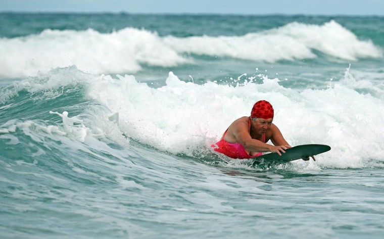 A belly boarder catches a wave as she takes part in the senior ladies heats of the annual World Belly Boarding Championships at Chapel Porth on September 8, 2013 in Cornwall, England. (Matt Cardy/Getty Images)