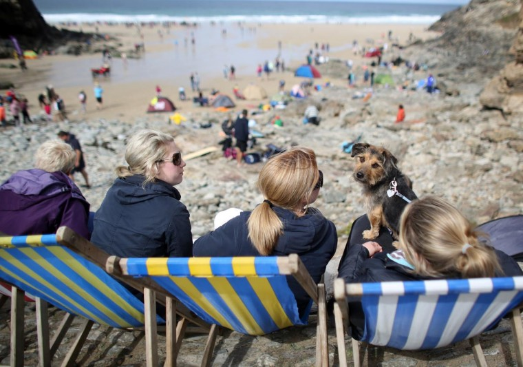 People sit in traditional deck chairs as they watch the annual World Belly Boarding Championships at Chapel Porth on September 8, 2013 in Cornwall, England. (Matt Cardy/Getty Images)