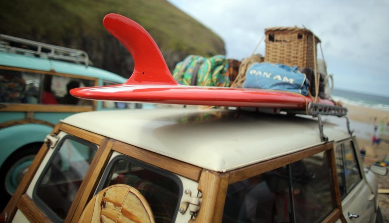 A vintage surf board is displayed on the roof of a classic Mini Traveller at the annual World Belly Boarding Championships at Chapel Porth on September 8, 2013 in Cornwall, England. (Matt Cardy/Getty Images)