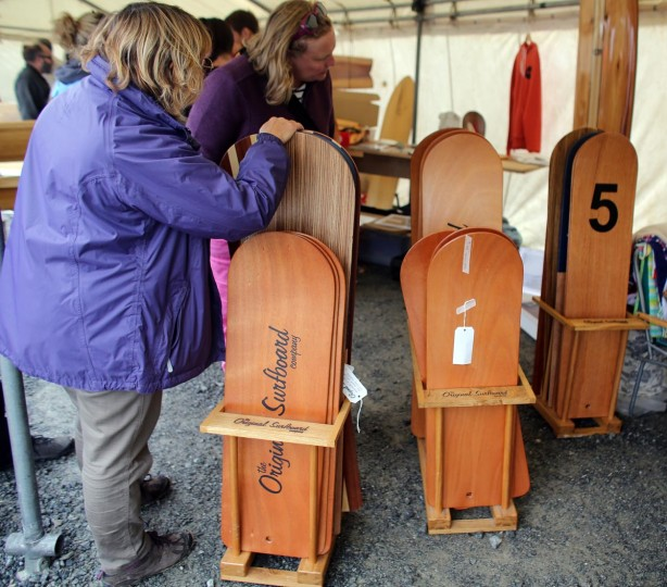 People stop to look at traditional bellyboards displayed for sale at the annual World Belly Boarding Championships at Chapel Porth on September 8, 2013 in Cornwall, England. (Matt Cardy/Getty Images)