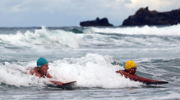 Belly boarders catch a wave as they take part in a senior ladies heat of the annual World Belly Boarding Championships at Chapel Porth on September 8, 2013 in Cornwall, England. (Matt Cardy/Getty Images)