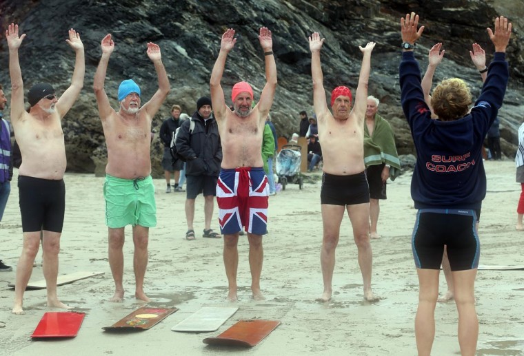 Belly boarders warm up on the beach prior to taking part in a senior mens heat during the annual World Belly Boarding Championships at Chapel Porth on September 8, 2013 in Cornwall, England. (Matt Cardy/Getty Images)