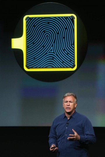 Phil Schiller, senior vice president of worldwide marketing for Apple Inc, speaks about security features of the new iPhone 5S during an Apple product announcement at the Apple campus on September 10, 2013 in Cupertino, California. (Justin Sullivan/Getty Images)