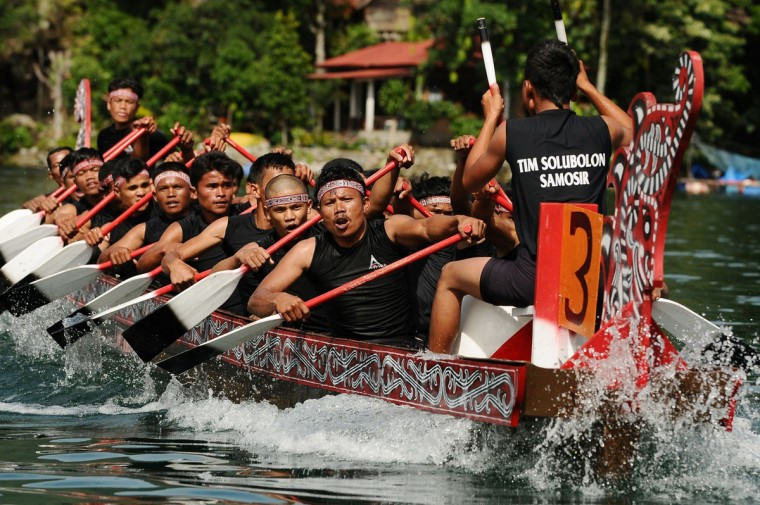 Solu Bolon Royal boat athletes compete as part of Lake Toba Festival 2013 on September 13, 2013 in Medan, Sumatra, Indonesia. (Robertus Pudyanto/Getty Images)