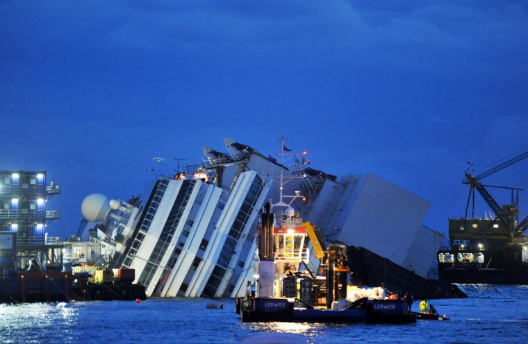 Titan and Micoperi workers are seen next to the stricken Costa Concordia on September 16, 2013 in Isola del Giglio, Italy. Work begins today to right the stricken Costa Concordia vessel, which sank on January 12, 2012. (Laura Lezza/Getty Images)