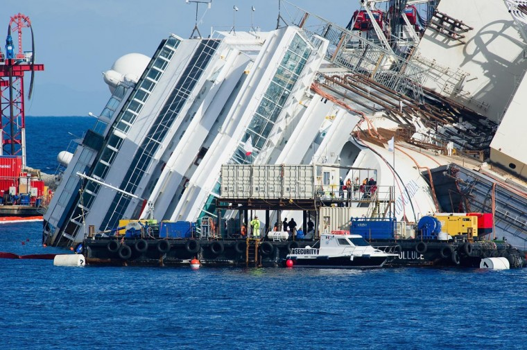 Engineers at work on the Costa Concordia as they attempt a salvage operation on September 16, 2013 in Isola del Giglio, Italy. (Marco Secchi/Getty Images)