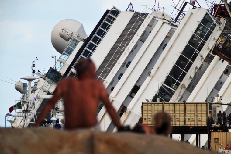 People watch as the parbuckling project to raise the stricken Costa Concordia continues on September 16, 2013 in Isola del Giglio, Italy. (Laura Lezza/Getty Images)