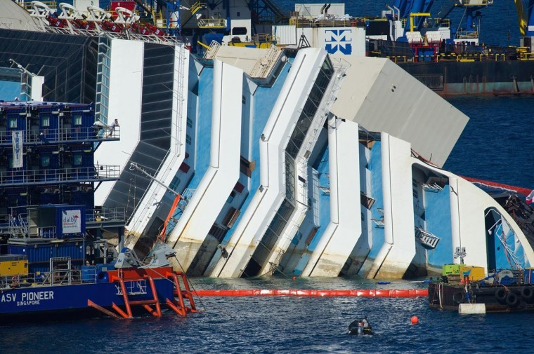 The water line that marks the former level of the stricken Costa Concordia is seen as the parbuckling project to raise the ship continues on September 16, 2013 in Isola del Giglio, Italy. (Marco Secchi/Getty Images)