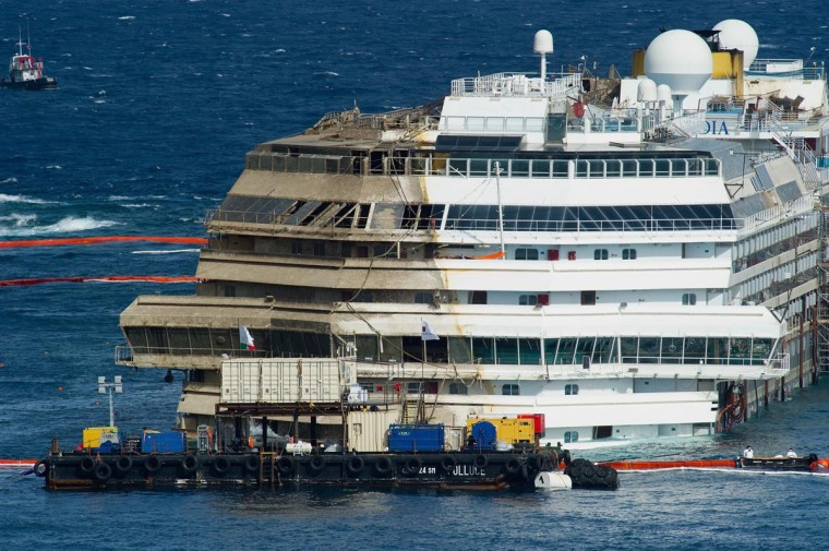 The stricken Costa Concordia is upright after the parbuckling operation was successfully completed around 4 am on September 17, 2013 in Isola del Giglio, Italy. (Marco Secchi/Getty Images)