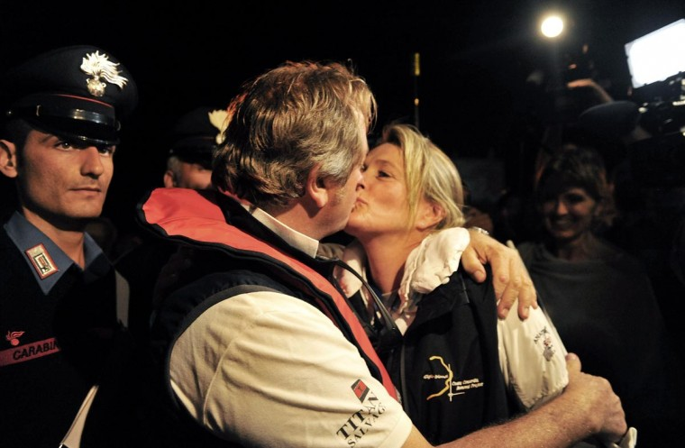 Senior Salvage Master Nick Sloane kisses his wife after the parbuckling operation which successfully uprighted the Costa Concordia, on September 17, 2013 in Isola del Giglio, Italy. (Laura Lezza/Getty Images)