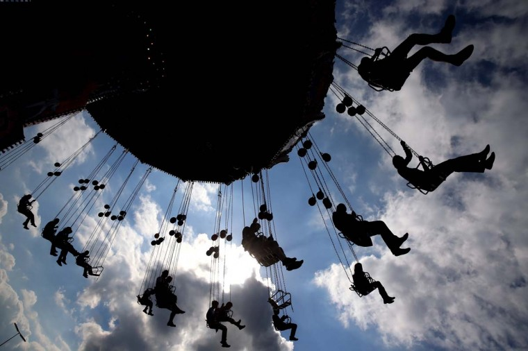 People enjoy riding on a merry-go-round at the Oktoberfest on September 21, 2013 in Munich, Germany. The Munich Oktoberfest, which this year will run from September 21 through October 6, is the world's largest beer fest and draws millions of visitors. (Alexander Hassenstein/Getty Images)