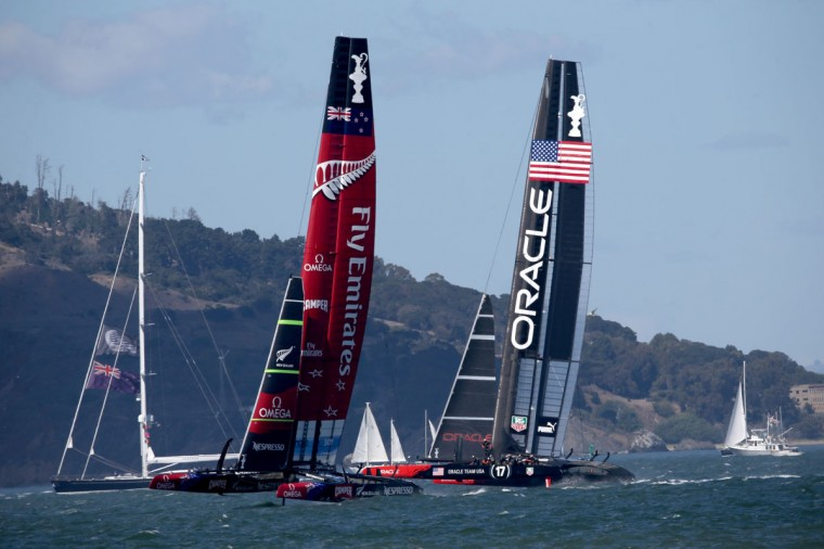 Emirates Team New Zealand, skippered by Dean Barker, and Oracle Team USA, skippered by James Spithill, compete during the final race of the America's Cup. (Photo by Justin Sullivan/Getty Images)
