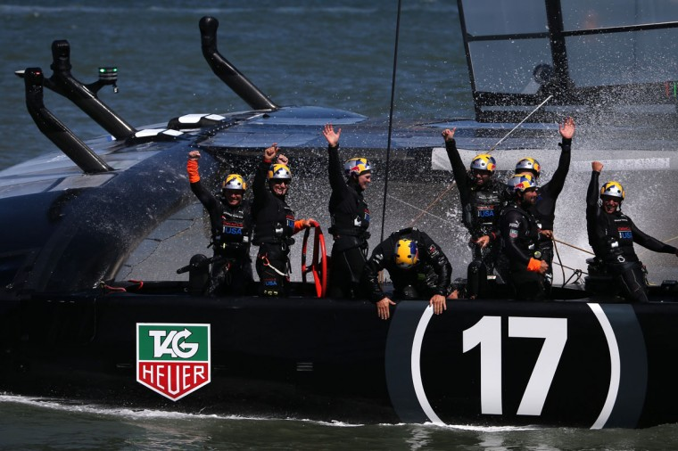 Oracle Team USA, skippered by James Spithill, celebrates after beating Emirates Team New Zealand to defend the America's Cup. (Photo by Justin Sullivan/Getty Images)