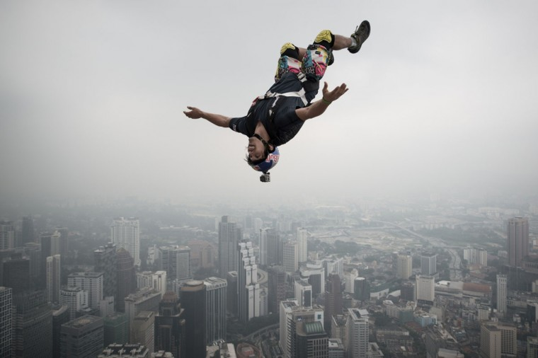 Base jumper Vincent Philippe Benjamin Reffet leaps from the 300-meter Open Deck of Malaysia's landmark Kuala Lumpur Tower during the International Tower Jump. (MOHD RASFAN / AFP/Getty Images)