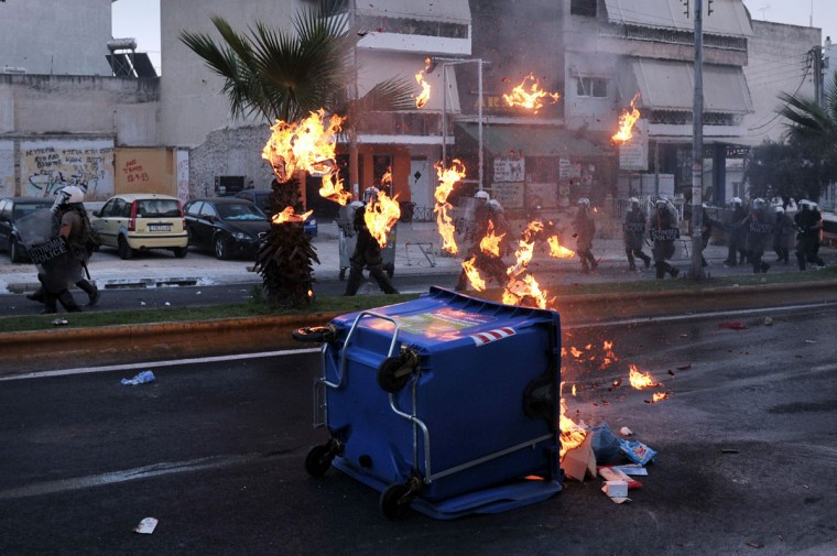 Police advance as they clash with anti-fascist protesters in the western Athens working class suburb of Keratsini. (LOUISA GOULIAMAKI / AFP/Getty Images)