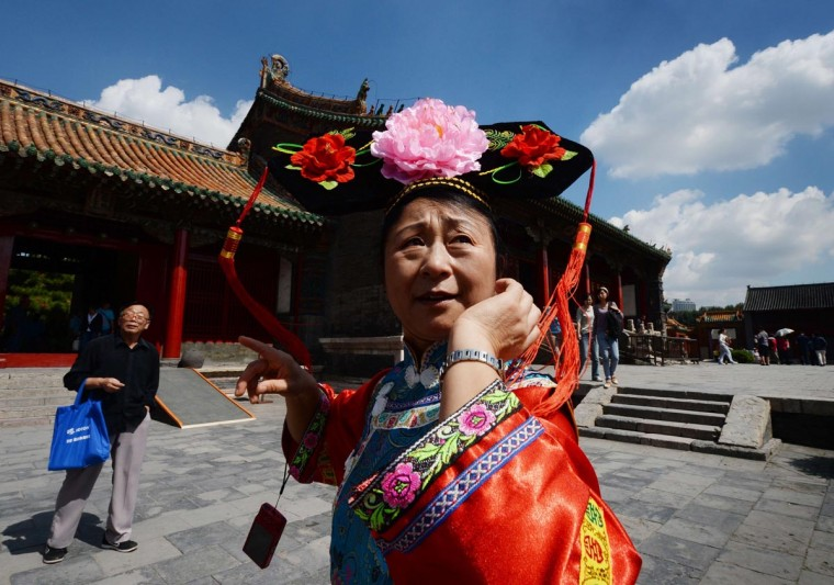 A Chinese woman dressed in an imperial Chinese costume tours the Manchu Imperial Palace in Shenyang, Liaoning Province on September 3, 2013. The palace built in 1625 was the home to the first three Qing (Manchu) Dynasty emperors and was listed as a UNESCO World Heritage site in 2004. (Mark Ralston/AFP/Getty Images)