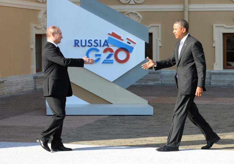 Russias President Vladimir Putin (L) welcomes US President Barack Obama at the start of the G20 summit on September 5, 2013 in Saint Petersburg. Russia hosts the G20 summit hoping to push forward an agenda to stimulate growth but with world leaders distracted by divisions on the prospect of US-led military action in Syria. (Yuri Kadobnov/AFP/Getty Images)