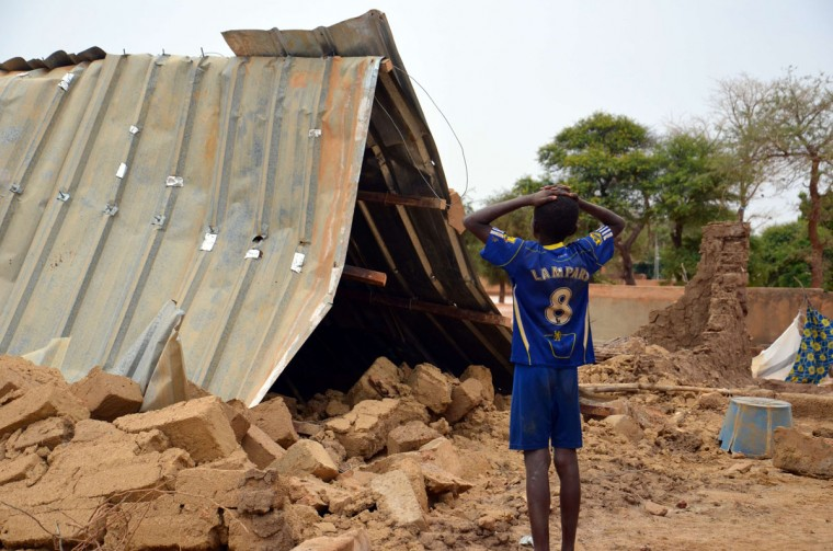 A young boy looks at the ruins of his parents' home in a district in Niamey, the capital city of Niger, where floods caused 26 casualties and affected 75,347 people and 13,000 hectares of farmland with damages estimated to 48.8 million euros, according to a statement. (Boureima Hama/AFP/Getty Images)