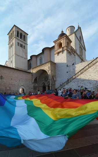 "People hold a big peace flag in front of the St Francis basilica in Assisi on September 7, 2013. Pope Francis called for the world to unite on Saturday in a day of fasting and prayer for Syria and said ""God and history"" would judge anyone using chemical weapons. (Vincenzo Pinto/AFP/Getty Images)"