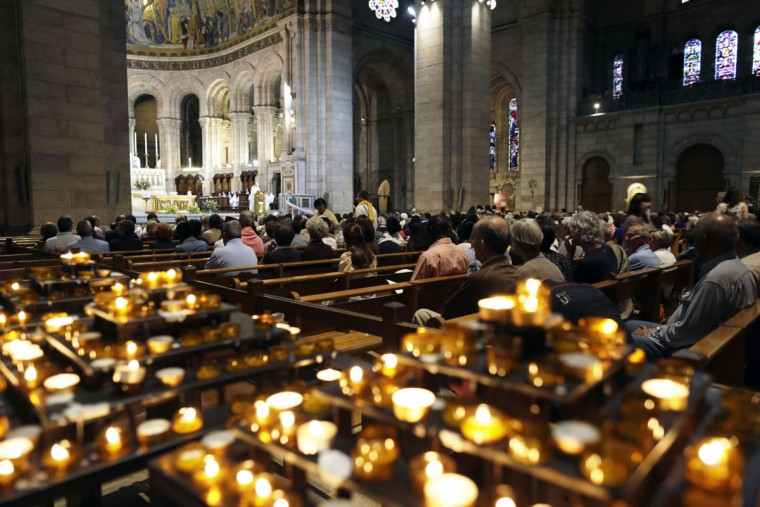 People pray during a vigil in the Sacre-Coeur Basilica in Paris on September 7, 2013. Pope Francis called for a global day of fasting and prayer for peace in Syria and against any armed intervention on Saturday, and led a five-hour vigil in Saint Peter's Square. (Kenzo Tribouillard/AFP/Getty Images)