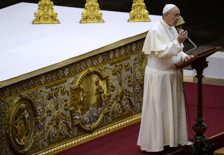 Pope Francis delivers a speech as he presides over a mass vigil for prayer for peace in Syria, in Saint Peter's Square at the Vatican, on September 7, 2013. Pope Francis called for the world to unite today in a day of fasting and prayer for Syria. (Andreas Solaro/AFP/Getty Images)