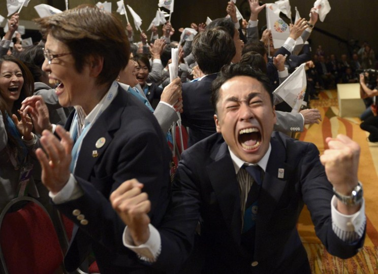 Tokyo 2020 delegation members celebrate after IOC president Jacques Rogge announced the Japanese capital to be the winner of the bid to host the 2020 Summer Olympic Games, during the 125th session of the International Olympic Committee (IOC), in Buenos Aires, on September 7, 2013. (Juan Mabromata/AFP/Getty Images)