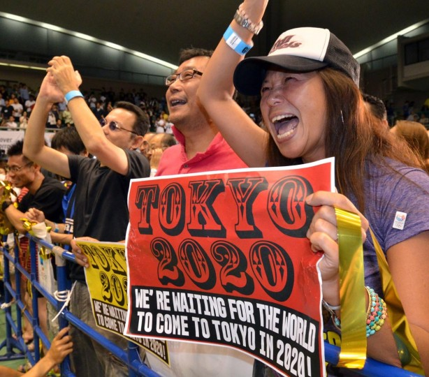 People celebrate as Tokyo wins the host city of the 2020 Olypics at the live-viewing event in Tokyo on September 8, 2013. Tokyo won the right to host the Olympic Games for the second time, overcoming fears about radiation from the stricken Fukushima nuclear plant to land the 2020 edition of the world's biggest sporting event. (Yoshikazu Tsuno/AFP/Getty Images)