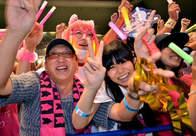 People celebrate as Tokyo wins the host city of the 2020 Olypics at the live-viewing event in Tokyo on September 8, 2013. (Yoshikazu Tsuno/AFP/Getty Images)