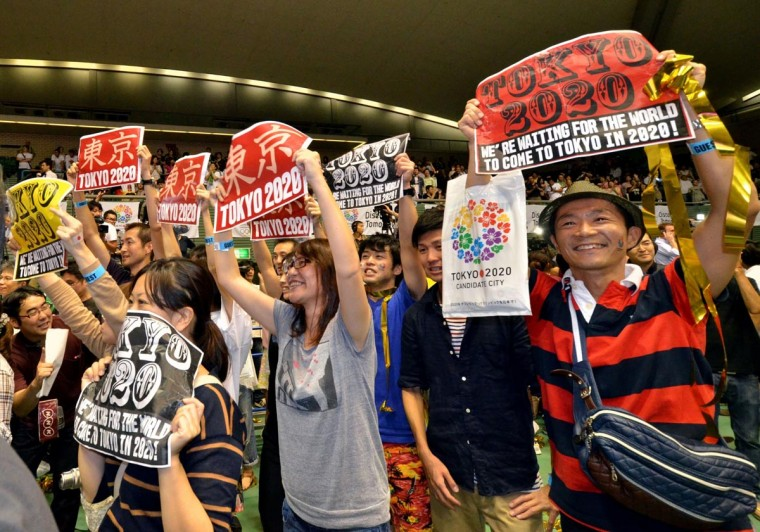 People celebrate as Tokyo wins the host city of the 2020 Olympics at the live-viewing event in Tokyo on September 8, 2013. (Yoshikazu Tsuno/AFP/Getty Images)