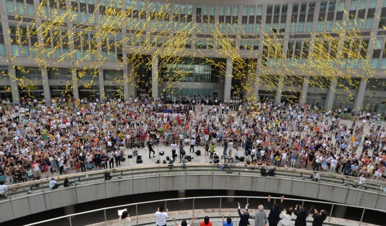 People gathered at the Tokyo metropolitan government building celebrate after Tokyo won its bid to be the host city of the 2020 Olympics, in Tokyo on September 8, 2013. (Kazuhiro Nogi/AFP/Getty Images)