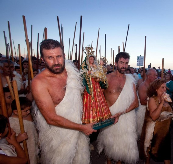 "People dressed up as ""Guanches"", the aboriginal Berber inhabitants of the Canary Islands, perform the apparition of the Virgin del Socorro to natives of Tenerife, on the beach of El Socorro, on the Spanish Canary island of Tenerife, on September 7, 2013. The pilgrimage of the Virgin of the Socorro is one of the oldest romerias of the Canary Islands and gather more than 70.000 people each year. (Desiree Martin/AFP/Getty Images)"