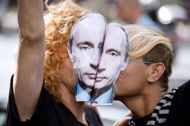 "Demonstrators wearing masks depicting Russian President Vladimir Putin kiss as they take part in a rally in front of the Russian embassy in Paris, on September 8, 2013, to protest against an ""anti-gay"" Russian law. (Lionel Bonaventure/AFP/Getty Images)"