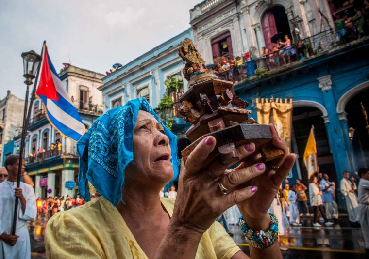 A Cuban faithful takes part in the procession of the Virgin of Charity on September 8, 2013 in Havana. (Amil Lagey/AFP )