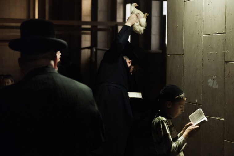 An ultra-Orthodox Jewish man performs the Kaparot ritual in the coastal Israeli city of Ashdod early on September 13, 2013 in line with the Jewish tradition of transferring the sins of the past year to the chicken before the Day of Atonement, or Yom Kippur. (David Buimovitch/AFP/Getty Images)