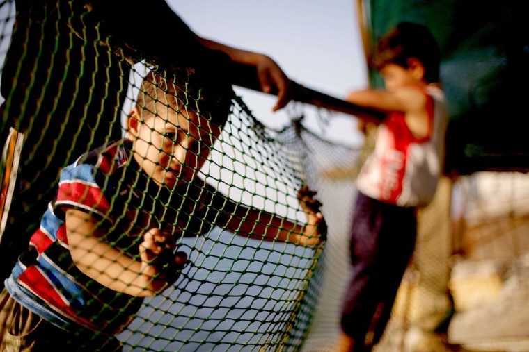 Palestinian children play in the Shati refugee camp in Gaza City on September 13, 2013. (Mohammed Abed/AFP/Getty Images)