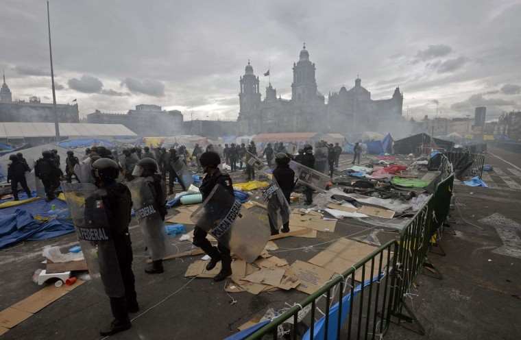 Mexican Federal Police are pictured in the surroundings of Mexico City's Zocalo Square during clashes with teachers protesting against an education reform. (Alfredo Estrella / AFP/Getty Images)