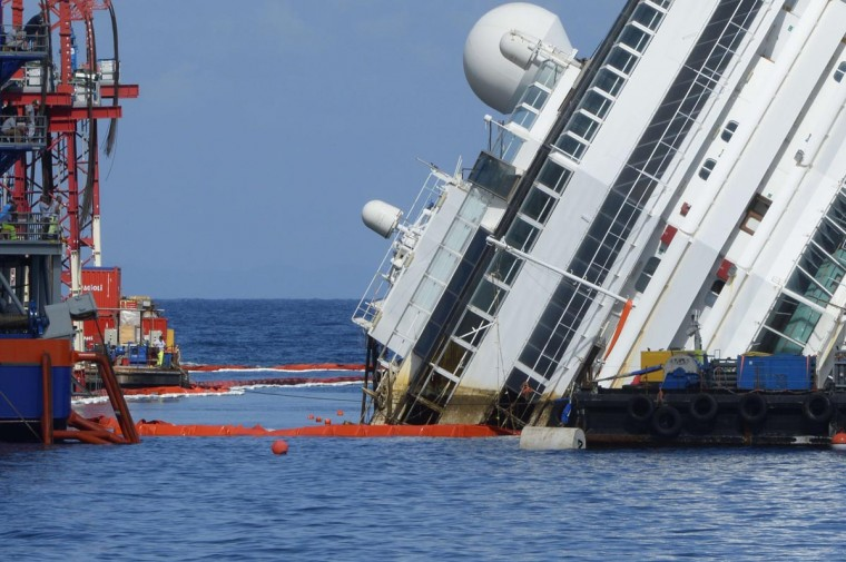 The Costa Concordia cruise ship wreck begins to emerge from water on September 16, 2013 near the village of Giglio Porto. (Andreas Solaro/AFP/Getty Images)