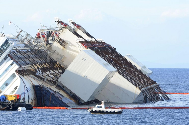 Members of the U.S. salvage company Titan and Italian firm Micoperi work at the wreck of Italy's Costa Concordia cruise ship near the harbor of Giglio Porto on September 16, 2013. (Andreas Solaro/AFP/Getty Images)