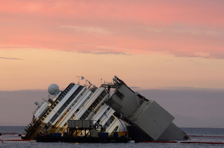A picture shows the wreck of Italy's Costa Concordia cruise ship during sunset near the harbour of Giglio Porto on September 16, 2013. (Andreas Solaro/AFP/Getty Images)