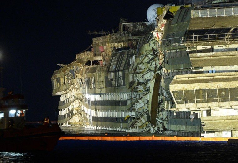 The wreck of Italy's Costa Concordia cruise ship begins to emerge from water on September 17, 2013 near the harbor of Giglio Porto. (Andreas Solaro/AFP/Getty Images)