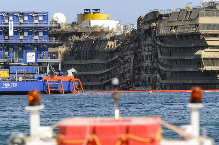 A picture taken on September 17, 2013 shows the wreckage of Italy's Costa Concordia cruise ship which begins to emerge from water near the harbor of Giglio Porto. (Andreas Solaro/AFP/Getty Images)