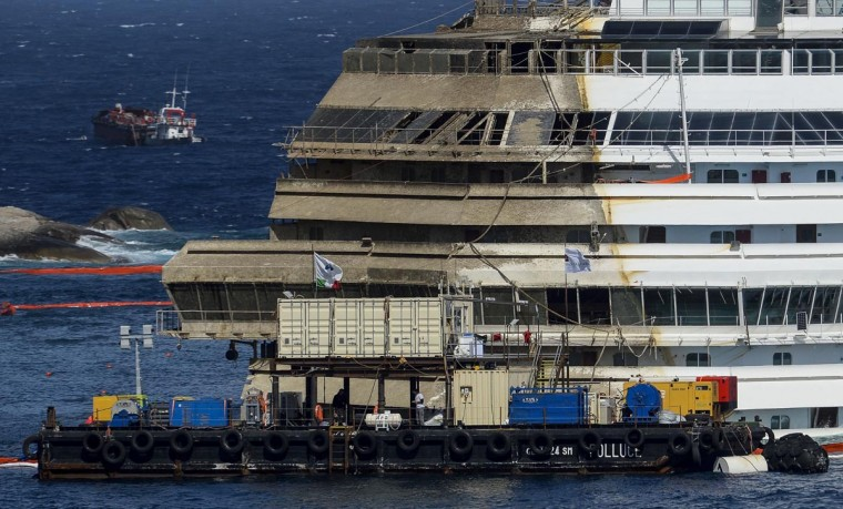 The wreck of Italy's Costa Concordia cruise ship begins to emerge from water on September 17, 2013 near the harbour of Giglio Porto. (Andreas Solaro/AFP/Getty Images)