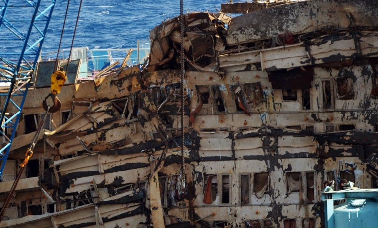 A picture taken on September 17, 2013 shows damaged windows of the wreckage of Italy's Costa Concordia cruise ship near the harbor of Giglio Porto. (Vincenzo Pinto/AFP/Getty Images)