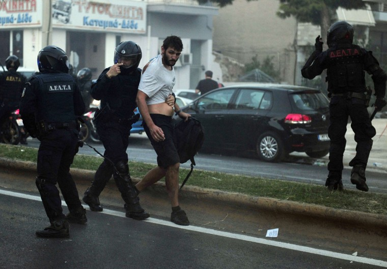 Police detain a protester during clashes in the western Athens working-class suburb of Keratsini after a leftist musician was murdered by a suspected neo-Nazi. (LOUISA GOULIAMAKI / AFP/Getty Images)