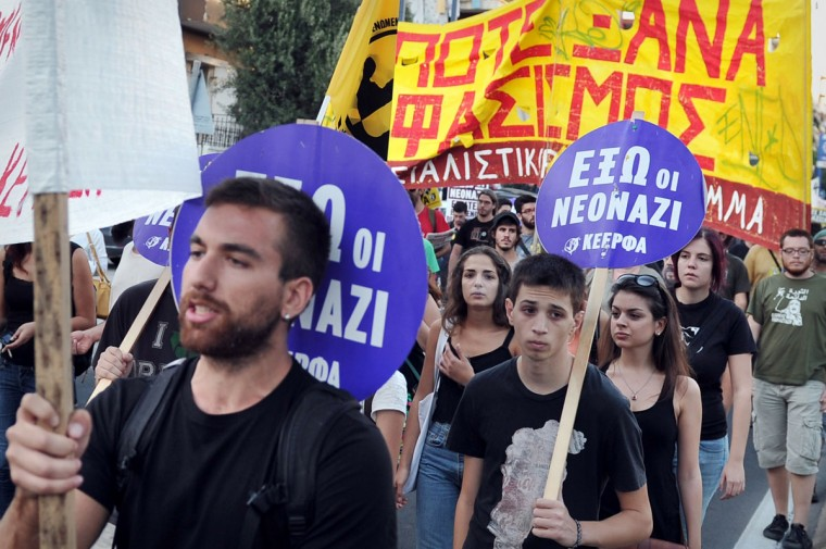 Anti-fascist protesters hold signs reading 'Fascism never again' as they take part in a protest rally in Athens. (ARIS MESSINIS / AFP/Getty Images)